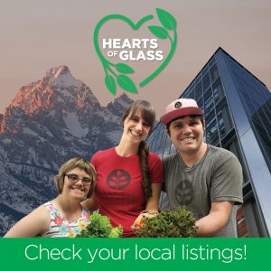 Two young women and a young man smile and hold out fresh produce; behind them is a modern looking building and mountains; the film logo a green heart adorned with leaves is above their heads